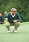 Seve Ballesteros lines up a putt in the rain at St. Mellion